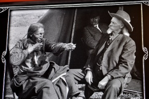 Buffalo Bill Cody and an Indian Chief telling a story in sign language.